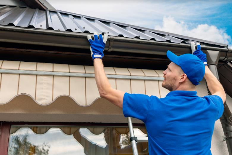 roofing contractor installing metal roof